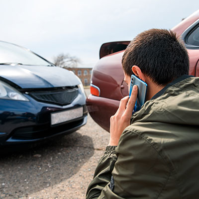 man on phone after car accident